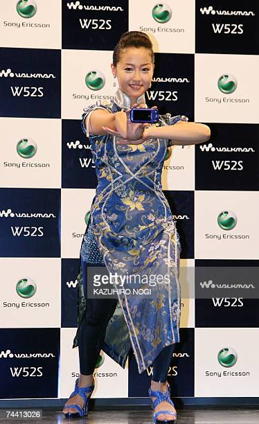 Erika Sawajiri a Japanese actress model and gravure idol poses with a mobile handset 'Walkman W52S' produced by Sony Ericsson during a press preview...