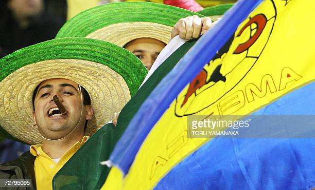 Fans of Mexico's Club America wave a flag during the first round match against South Korean Jeonbuk Hyundai Motors FC in the FIFA Club World Cup in...