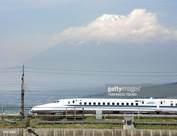 Japan Railway Tokai's new bullet train 'Shinkansen N700' speeds before Mount Fuji during a test run in Shizuoka prefecture central Japan 23 May 2007...