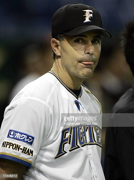 Japanese baseball team Nippon Ham Fighters head coach Trey Hillman from the US watches his players during their official training of the Konami Cup...