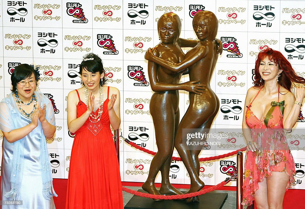 Japanese comedian Harisenbon, Haruna Kondo (L) and Haruka Minowa (2nd-L), introduce their nude statue made in chocolate during a press preview to promote their movie for the upcoming Valentine's Day celebrations in Tokyo, 08 February 2007. At right is Japanese pin-up Mika Kano, who's body curves were used to shape the nude statue.