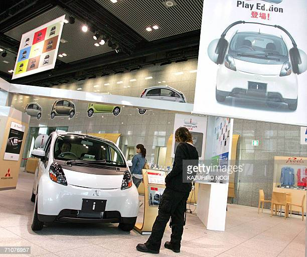 Japanese Mitsubishi Motors' stylish mini car 'i' loaded with an exclusive slot for the portable music player 'i Pod nano' is on display at a showroom...