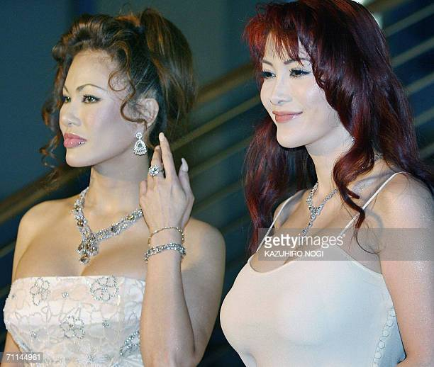Japanese sisters Kyoko Kano and Mika Kano pose for photographers upon their arrival at an diamond jewellry collection as part of 'A Celebration of...