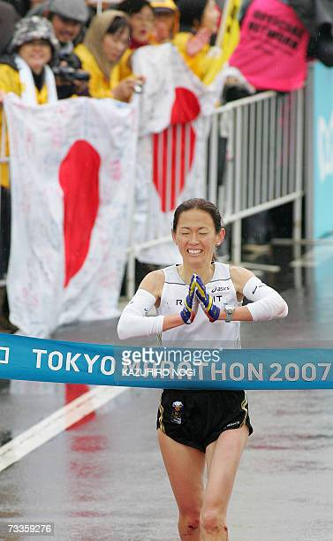 Japanese twotime Olympic medallist Yuko Arimori crosses the finish line in the women's category of the Tokyo Marathon 18 February 2007 Arimori took...