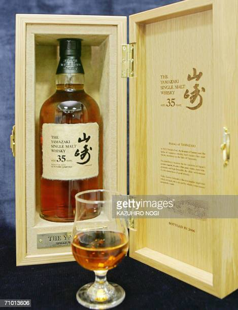 Japan's liquour giant Suntory displays a bottle of the Yamazaki single malt whisky aged 35 years during a press preview in Tokyo 23 May 2006 Suntory...