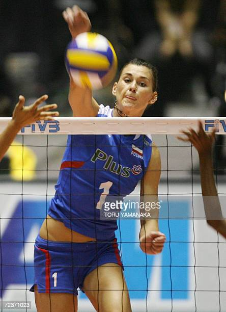 Katarzyna SkowronskaDolata spikes the ball through the block of Costa Rican players during their first round match at the Women's World Volleyball...