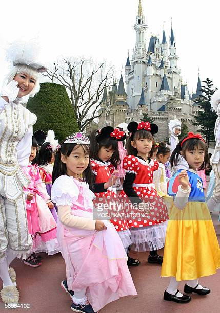 Little girls in clad of Disney characters' princess such as Cinderella Snow White parade before a castle for the celebration of Girls' Festival at...