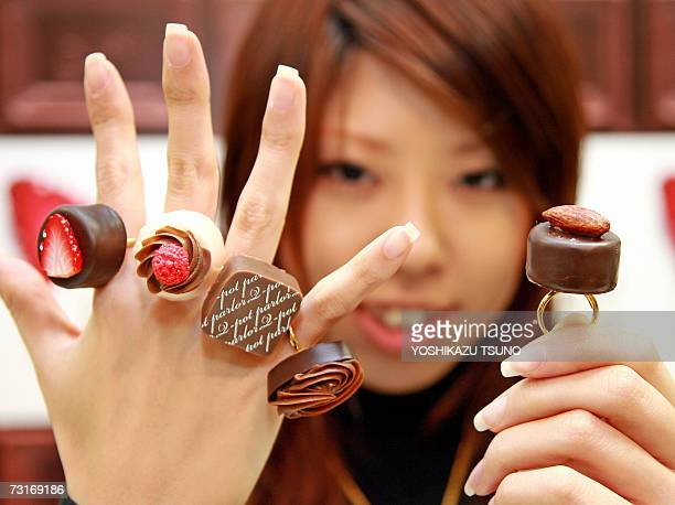 Nami Saeki a sales clerk of Japan's accessory shop Qpot shows off assorted chocolatelike creation rings priced 3780 yen and 4200 yen at Takashimaya...