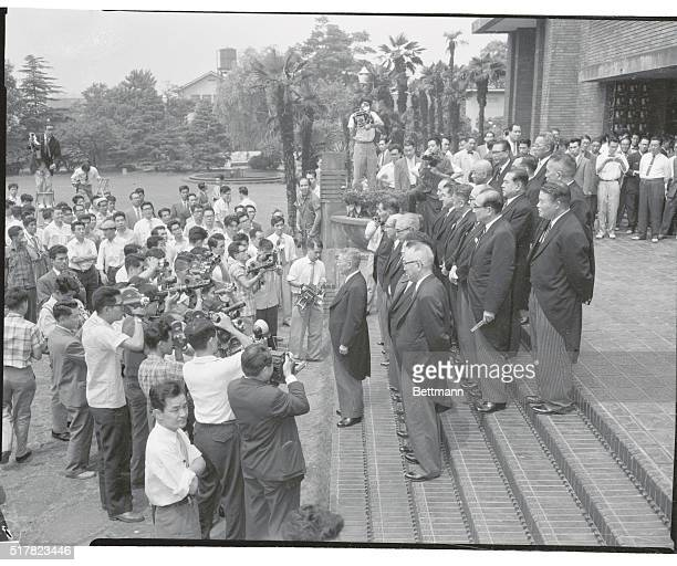 New Japanese Cabinet Members Standing on the steps of the Prime Minister's official residence here after being formally attested by the Emperor in...