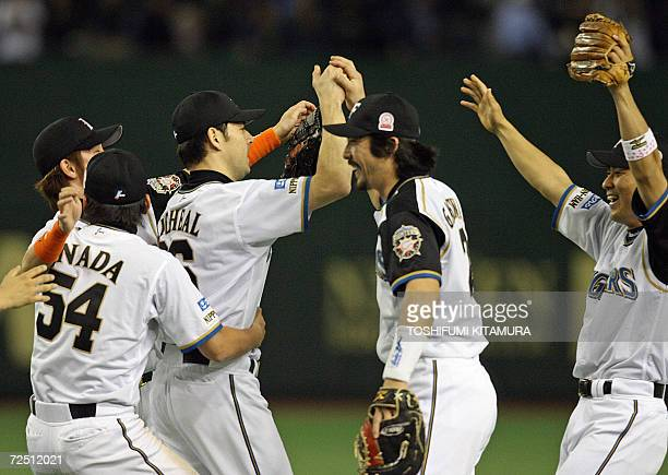 Nippon Ham Fighters closing pitcher Michael Nakamura is congraturated by first baseman Michihiro Ogasawara and other teammates after their victory...