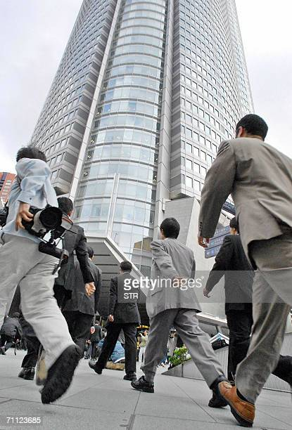 Prosecutors raid the office of a highprofile Japanese fund manager Yoshiaki Murakami in Toyko 05 June 2006 Murakami was arrested on suspicion of...