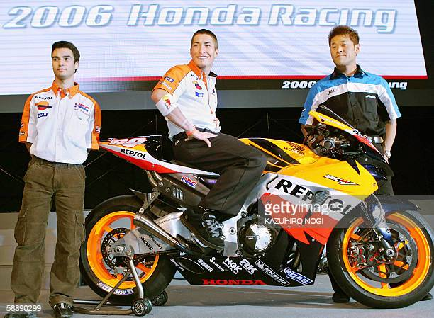 Repsol Honda Team's MotoGP riders American Nicky Hayden Spanish Dani Pedrosa and Japanese Makoto Tamada of JiR Konica Minolta Honda Team pose during...