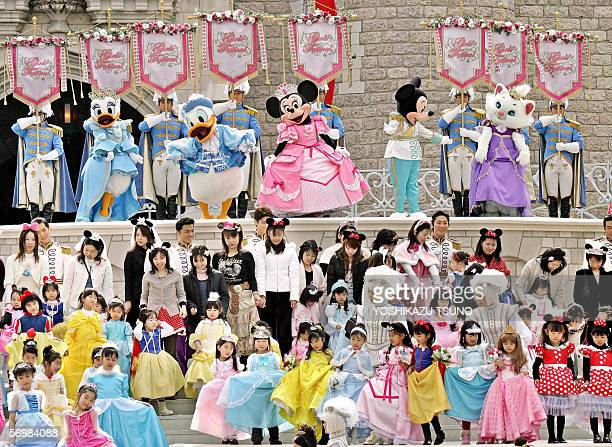 Some 300 girls and women in clad of Disney characters' princess such as Cinderella Snow White pose with Mickey Minnie Mouse and Disney characters...