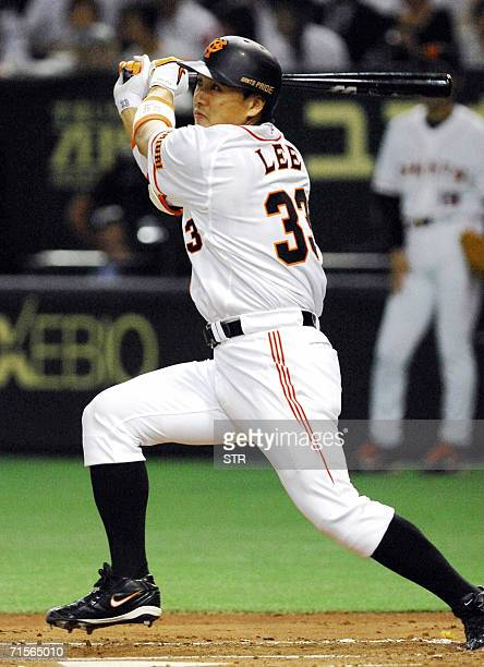 South Korean slugger Lee Seungyeop of the Yomiuri Giants hits the ball in a Japan's professional baseball league match against the Hanshin Tigers at...