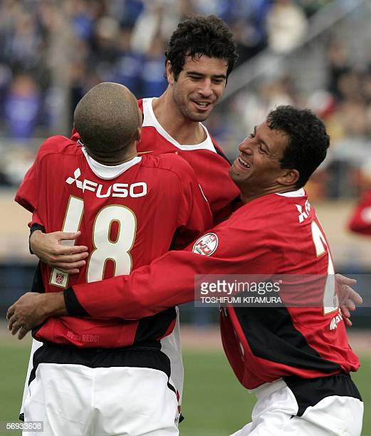 Urawa Reds midfielder Robson Ponte from Brazil is celebrated his goal by teammates Shinji Ono and Washington from Brazil during the Xerox Super Cup...