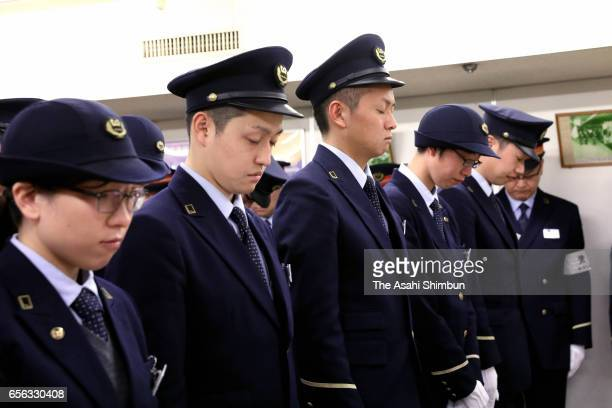 Tokyo Metro staffs observe a minute of silence on the day marking the 22nd anniversary of the Sarin nerve gas attack at Kasumigaseki Station on March...