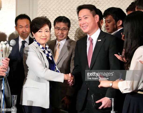Tokyo Metropolitan Governor and Kibo no To head Yuriko Koike and the Democratic Party Preesident Seiji Maehara speak to media reporters after their...