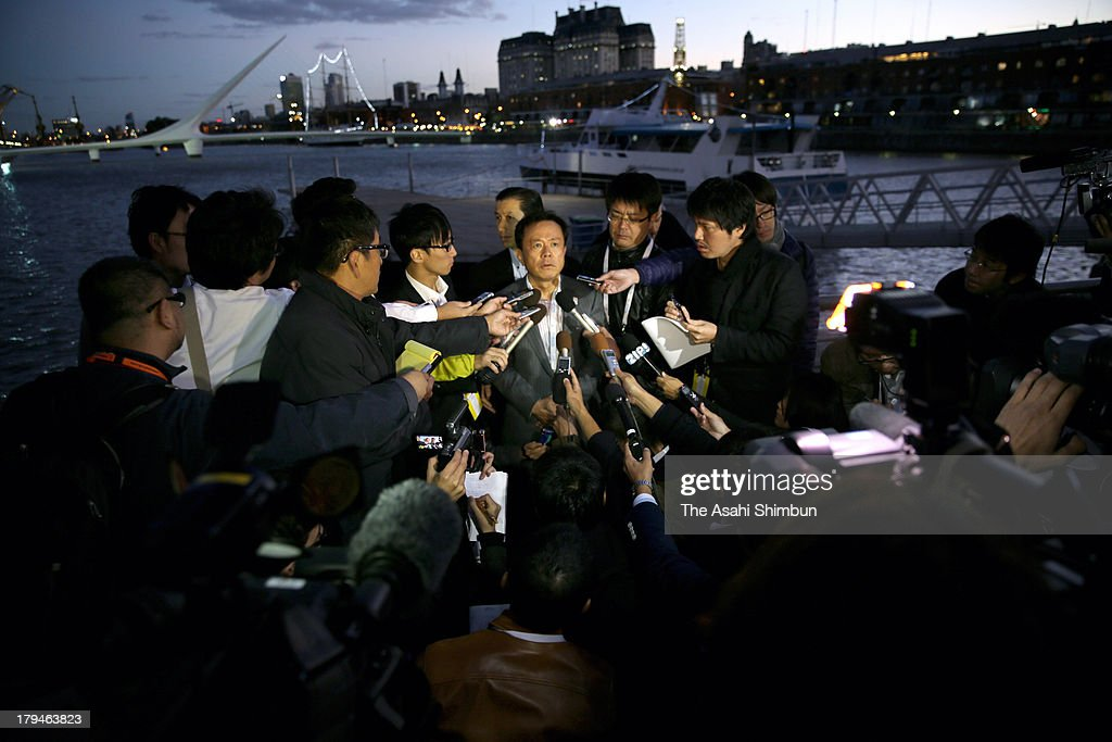 Tokyo metropolitan governor Naoki Inose is surrounded by media reporters after the rehearsal of their bid presentation on September 3, 2013 in Buenos Aires, Argentina. The host city of 2020 Summer Olympic will be decided on September 7.