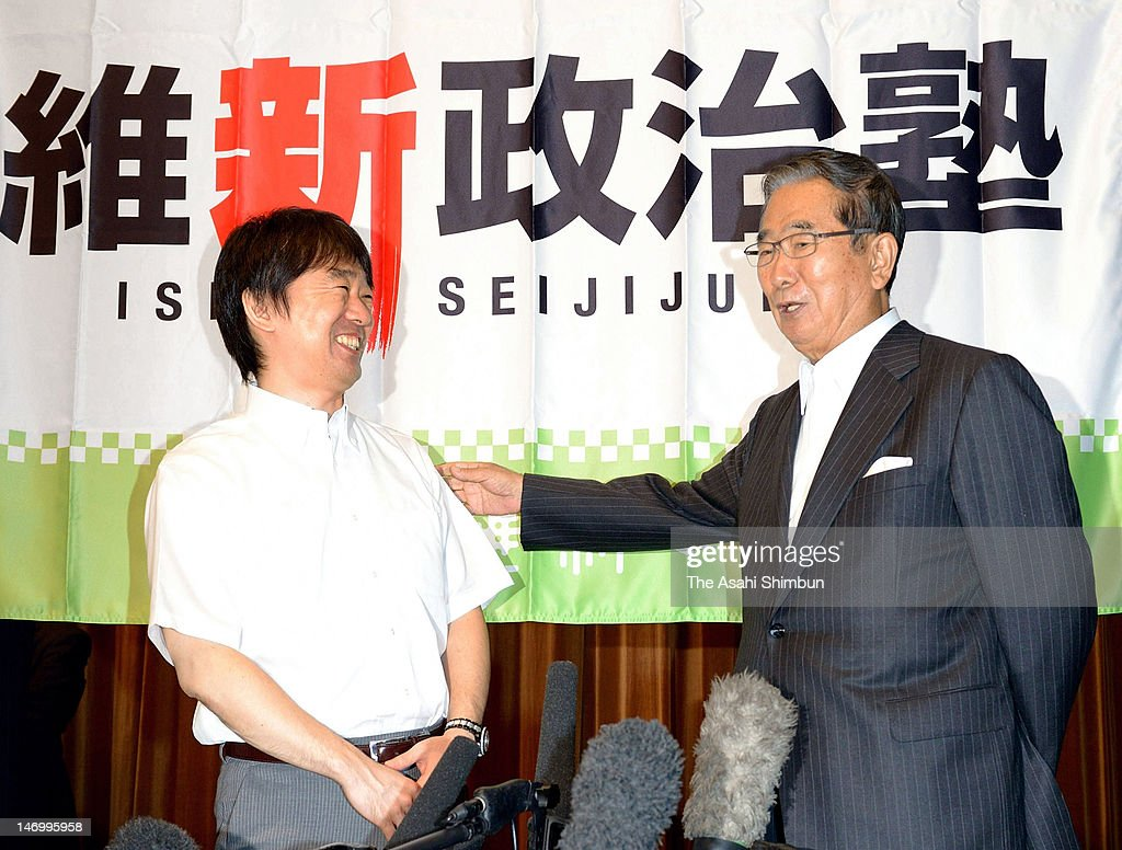 Tokyo Metropolitan Governor <a gi-track='captionPersonalityLinkClicked' href=/galleries/search?phrase=Shintaro+Ishihara&family=editorial&specificpeople=665335 ng-click='$event.stopPropagation()'>Shintaro Ishihara</a> (R) and Osaka City Mayor <a gi-track='captionPersonalityLinkClicked' href=/galleries/search?phrase=Toru+Hashimoto&family=editorial&specificpeople=4847016 ng-click='$event.stopPropagation()'>Toru Hashimoto</a> speak to media during the Hashimoto's local Party 'Osaka Ishin-no-kai' political school at Osaka City Central Public Hall on June 23, 2012 in Osaka, Japan.