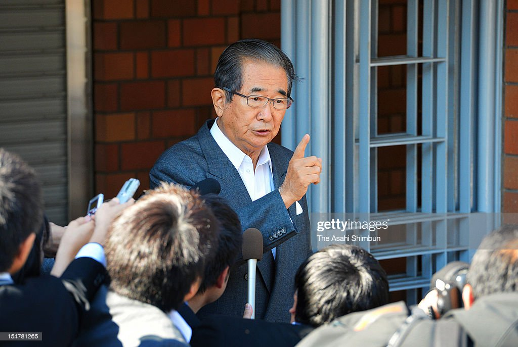 Tokyo Metropolitan Governor <a gi-track='captionPersonalityLinkClicked' href=/galleries/search?phrase=Shintaro+Ishihara&family=editorial&specificpeople=665335 ng-click='$event.stopPropagation()'>Shintaro Ishihara</a> points to the sky as he is asked the feeling, saying 'as clear as this blue sky', a day after his resignation announcement on October 26, 2012 in Tokyo, Japan. Ishihara is to form his new party with five members of the Sunrise Party of Japan.