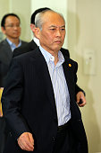 Tokyo Metropolitan Governor Yoichi Masuzoe leaves the room after attending a directors meeting of the assembly's steering committee at the Tokyo...