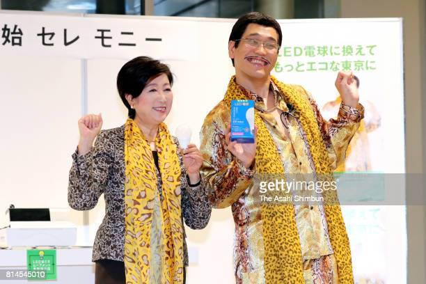 Tokyo Metropolitan Governor Yuriko Koike and Pikotaro pose for photographs during a launching ceremony of the LED bulb exchange on July 10 2017 in...