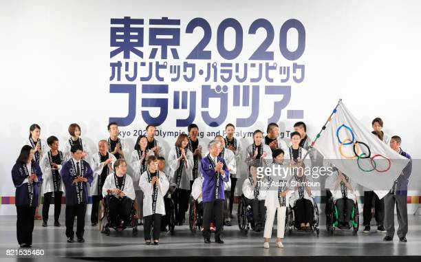 Tokyo Metropolitan Governor Yuriko Koike waves the Olympic flag during the ceremony marking the three years to go to the Tokyo Summer Olympic Games...