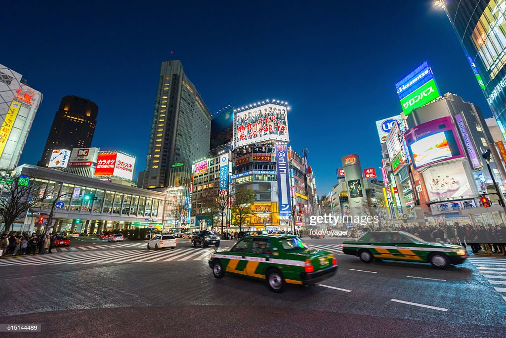 Tokyo neon night illuminated crowds traffic in futuristic cityscape Japan