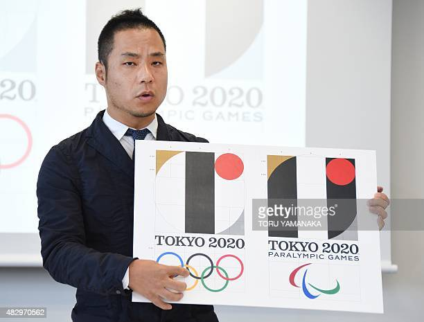 Tokyo Olympic logo designer Kenjiro Sano explains his design during a press conference at the headquarters of Tokyo 2020 in Tokyo on August 5 2015...
