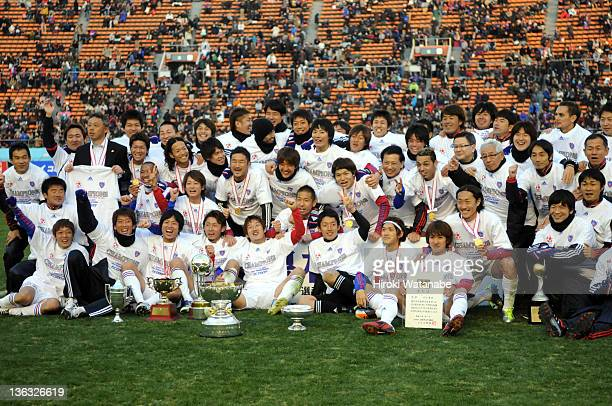 FC Tokyo players celebrate the win after the Emperor's Cup Final match between Kyoto Sanga and FC Tokyo at the National Stadium on January 1 2012 in...