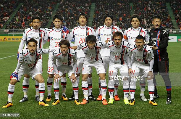 Tokyo players line up during the AFC Champions League Group E match between Jeonbuk Hyundai Motors and FC Tokyo at Jeonju World Cup Stadium on...