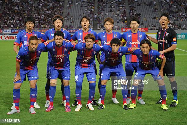 FC Tokyo players line up for the team photos prior to the JLeague match between FC Tokyo and Albirex Niigata at Ajinomoto Stadium on July 15 2015 in...