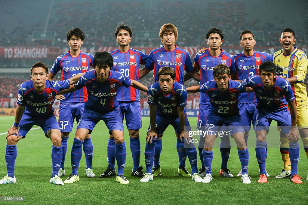 FC Tokyo players line up prior to the 1/8 match of AFC Asia Champions League between Shanghai SIPG and FC Tokyo at Shanghai Stadium on May 24, 2016 in Shanghai, China.