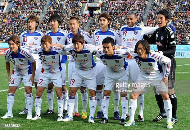 FC Tokyo players pose for photographs prior to the Emperor's Cup Final match between Kyoto Sanga and FC Tokyo at the National Stadium on January 1...