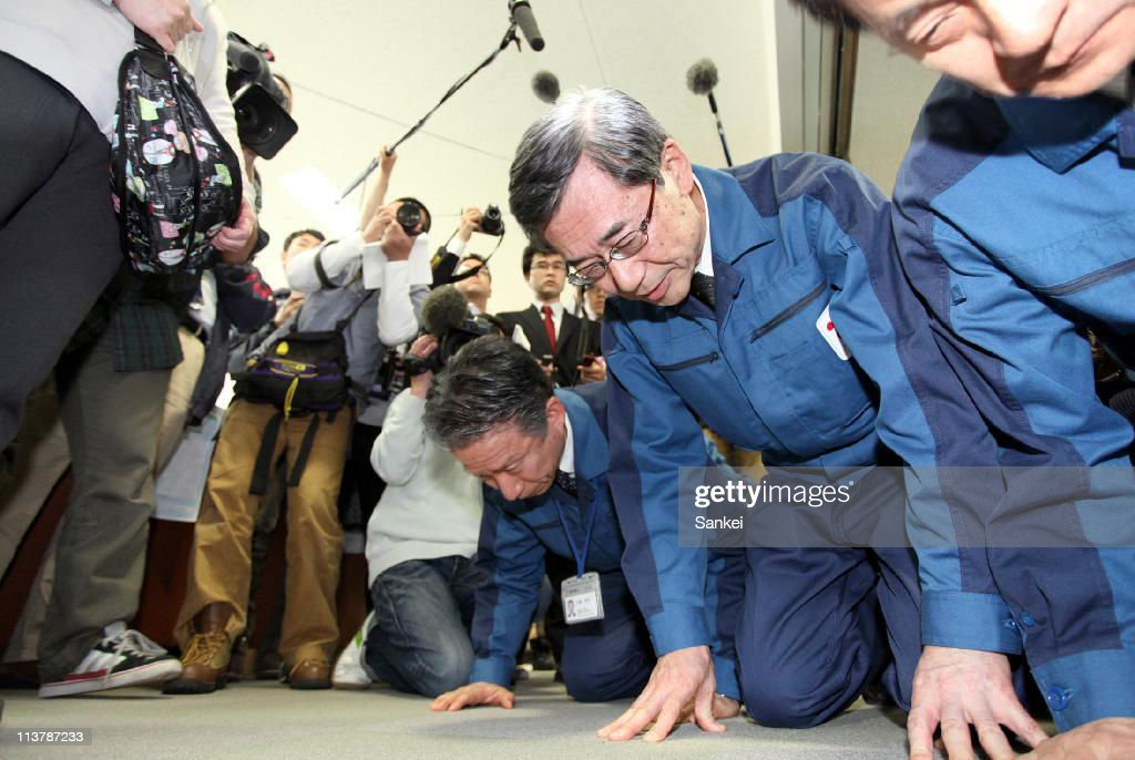 Tokyo Power Electric Co., (TEPCO) President Masataka Shimizu kneels and bows for apology toward evacuated Namie Town residents at Nihonmatsu City Hall Towa Branch on May 4, 2011 in Nihonmatsu, Fukushima, Japan. Japanese government have prohibited to enter within 20km radius zone from the troubled Fukushima Daiichi Nuclear Power Plant and will determine early next year if the evacuees could return their homes.