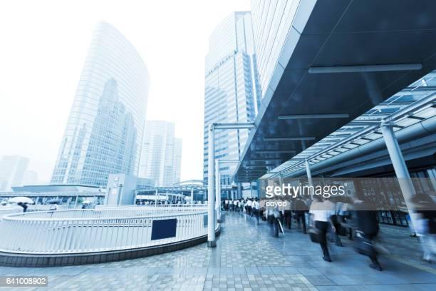 Tokyo Rainy Commuters Walking Through Pedestrian Walkway in the Morning