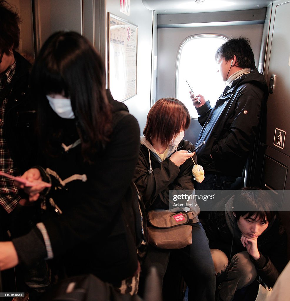 Tokyo residents cram into the Shinkansen (Bullet Train) as they leave Tokyo heading west days after the earthquake struck on March 16, 2011 in Tokyo, Japan. The 9.0 magnitude strong earthquake struck offshore on March 11 at 2:46pm local time, triggering a tsunami wave of up to ten metres which engulfed large parts of north-eastern Japan. The death toll continues to rise and could well reach 10,000 in a tragedy not seen since World War II in Japan.