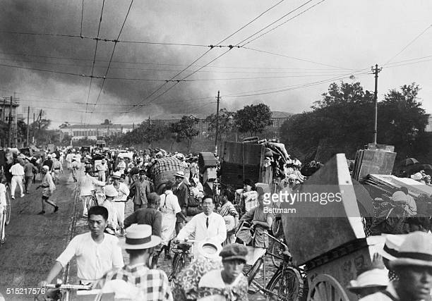 Tokyo residents flee with their belongings after the 1923 earthquake and fire