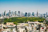 Tokyo skyline towards Shibuya and Shinjuku. Yoyogi park in the middle.