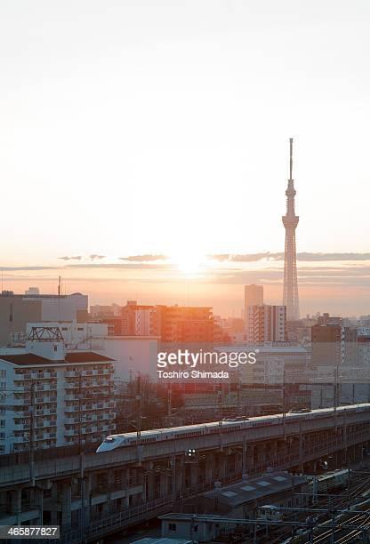 Tokyo skytree aad bullet train at dawn