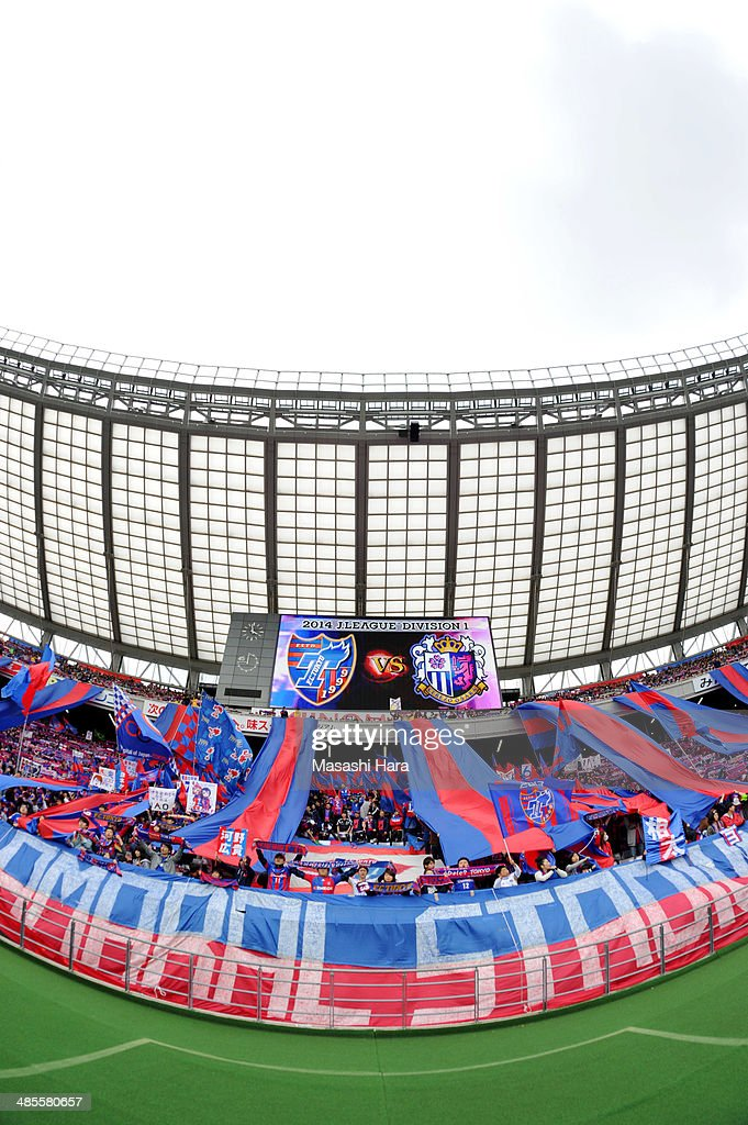 FC Tokyo supporters hold mufflers and sing a song prior to the J.League match between F.C. Tokyo and Cerezo Osaka at Ajinomoto Stadium on April 19, 2014 in Tokyo, Japan.