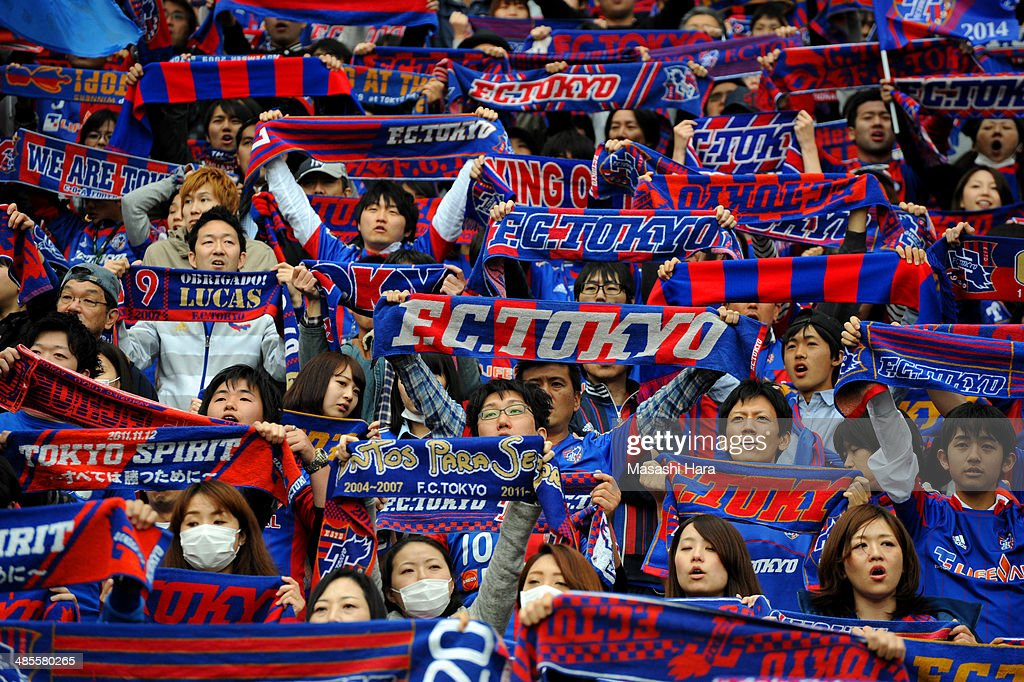 FC Tokyo supporters hold mufflers prior to the J.League match between F.C. Tokyo and Cerezo Osaka at Ajinomoto Stadium on April 19, 2014 in Tokyo, Japan.