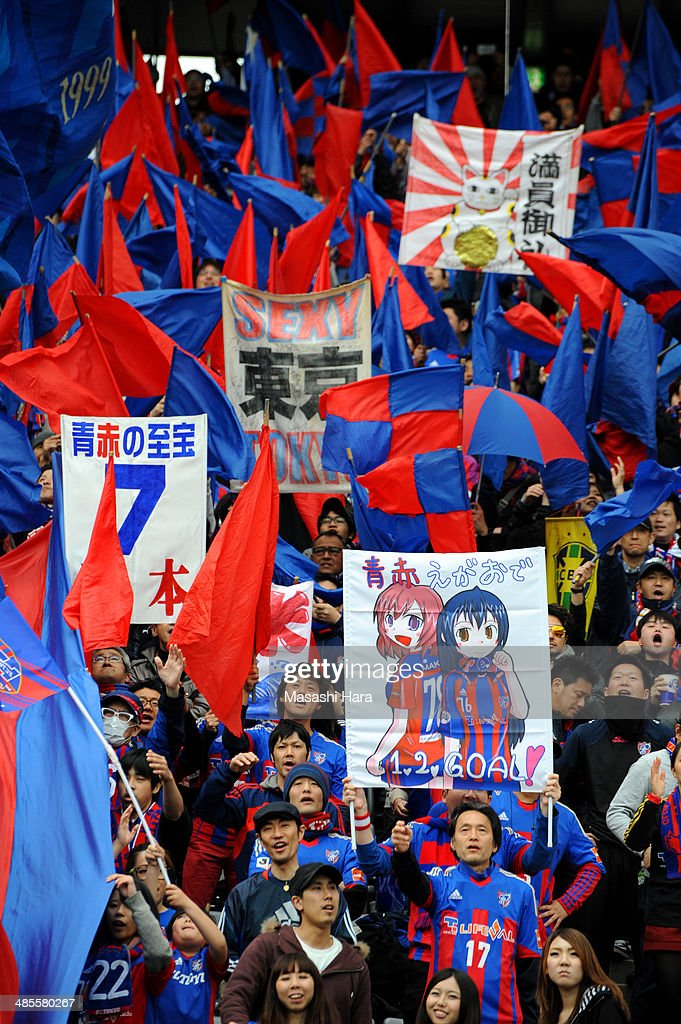 FC Tokyo supporters wave flags prior to the J.League match between F.C. Tokyo and Cerezo Osaka at Ajinomoto Stadium on April 19, 2014 in Tokyo, Japan.