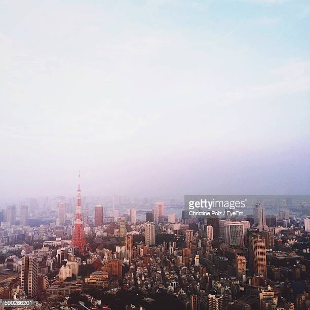 Tokyo Tower And Cityscape Against Sky At Morning