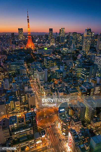 Tokyo Tower futuristic skyscraper cityscape overlooking illuminated streets dusk Japan