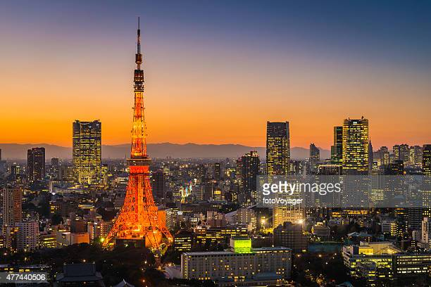 Tokyo Tower skyscrapers neon futuristic cityscape illuminated sunset Japan