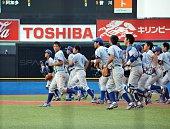 Tokyo University baseball team players celebrate their victory over Hosei University at the Jingu baseball stadium in Tokyo on May 23 2015 Japan's...