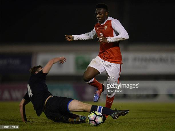 Tolaji Bola of Arsenal takes on Charley Doyle of Blackburn during the Premier League match between Arsenal and Stoke City at Meadow Park on December...