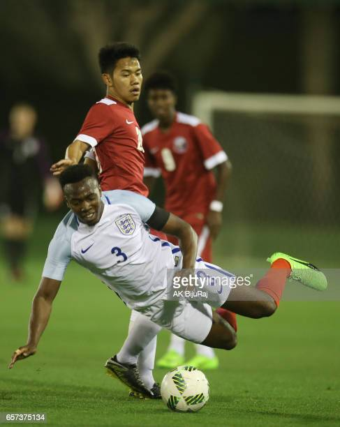 Tolaji Bola of England in action against Andri Syahputra of Qatar during the England and Qatar U 18 friendly match at the Aspire pitch on March 24...