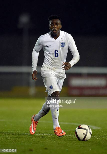 Tolaji Bola of England U16 in action during the Victory Shield match between Wales U16 and England U16 at the Book People Stadium on October 31 2014...